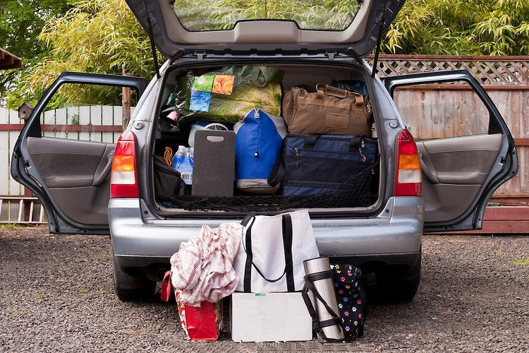 Car packed with suitcases and bags and coolers